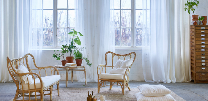 bright living room featuring mullion windows with one layer of sheer