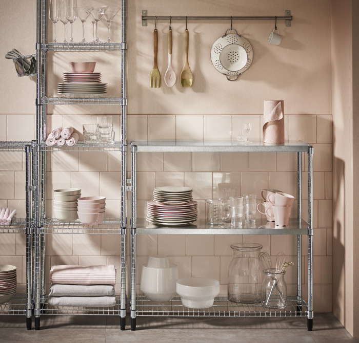 Shelving units in galvanized steel with covers for wire shelves to make them more even and stable.