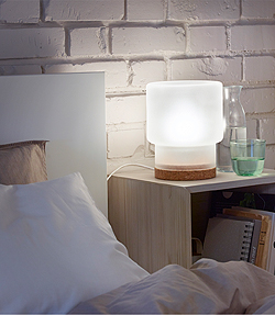 A bedside lamp with soft glow for winding down.