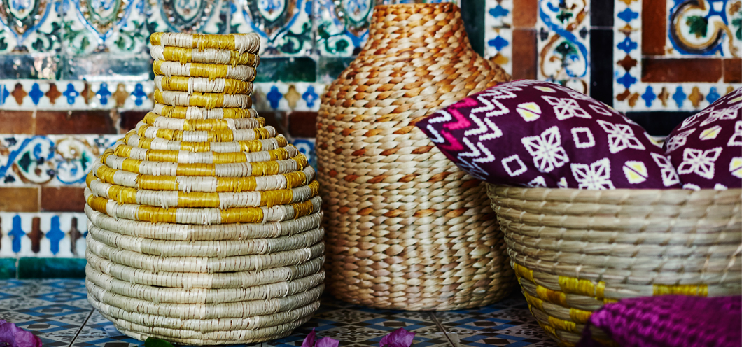 Two hand-woven decoration vases and a bowl, made of natural materials.