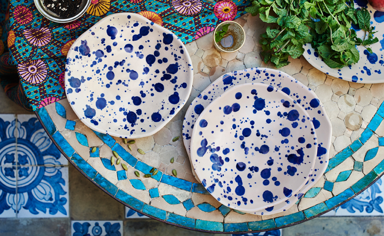 Stoneware plates in two sizes, hand-painted with blue dots.
