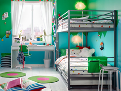 A blue, green and white children's bedroom with a silver bunk bed and pull-out bed.
