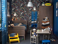 Dark brown and deep blue children's bedroom with a bed, wardrobe and table.