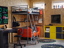 Colourful teenager's bedroom with partical board walls and metal loft bed.