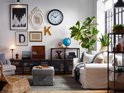 Eclectic living room with gallery wall and industrial style wood and metal shelving.