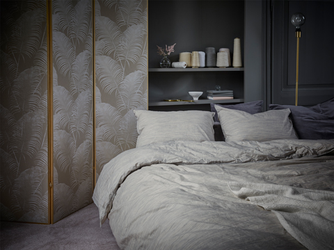 A bed with quilt cover and two pillowcases made of beige 100% cotton with fine shifting colours, shown in a grey bedroom.