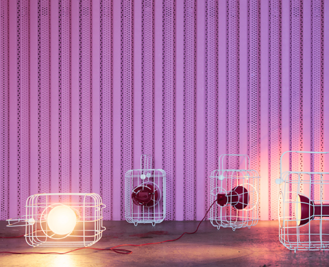 Four red chargeable flashlights, each in a white cage, inspired by old railway lanterns. Runs on rechargeable batteries, USB cord or transformer.