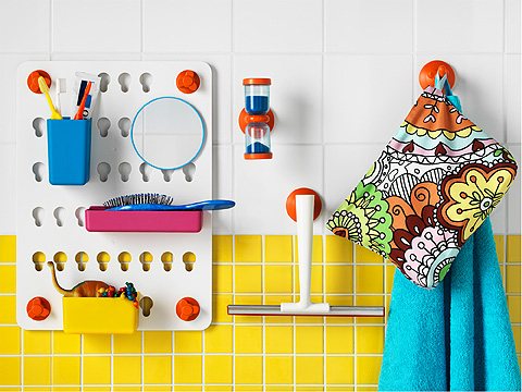 Colourful wall mounted bathroom storage for children.