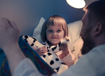 Play mode. Click. Bedtime story mode. With IKEA Smart lighting you can set the mood in a second, and from now on, even with the sound of your voice – it's so easy a child can do it!