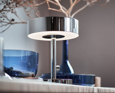This table lamp from the new STOCKHOLM 2017 collection is an exquisite element of design with added functionality. In chrome-plated steel with frosted glass panels, it spreads a dimmable light both upwards and downwards.