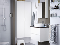 A grey and white bathroom with white washstand and cabinet.