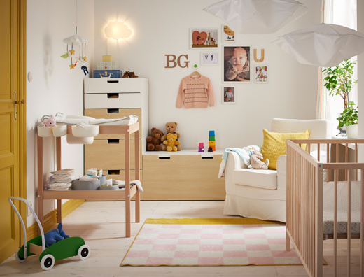 Fresh white, wood and yellow nursery with cot, changing table and storage.