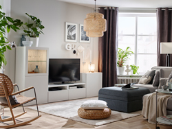 Neutral TV corner with cosy seating and sleek open and closed storage under the screen.