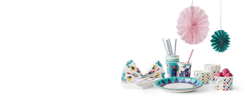 Display of party accessories, such as hanging decorations, disposable mugs, paper napkins and ice cream cups, all with colourful and fun patterns.