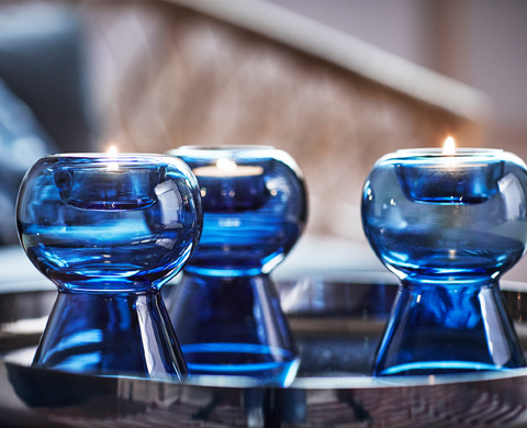 Are you sure you see just three STOCKHOLM 2017 candle holders in transparent blue glass in this picture? You can flip them the other way round, with the open side facing up and they become vases for your beautiful flower bouquets.