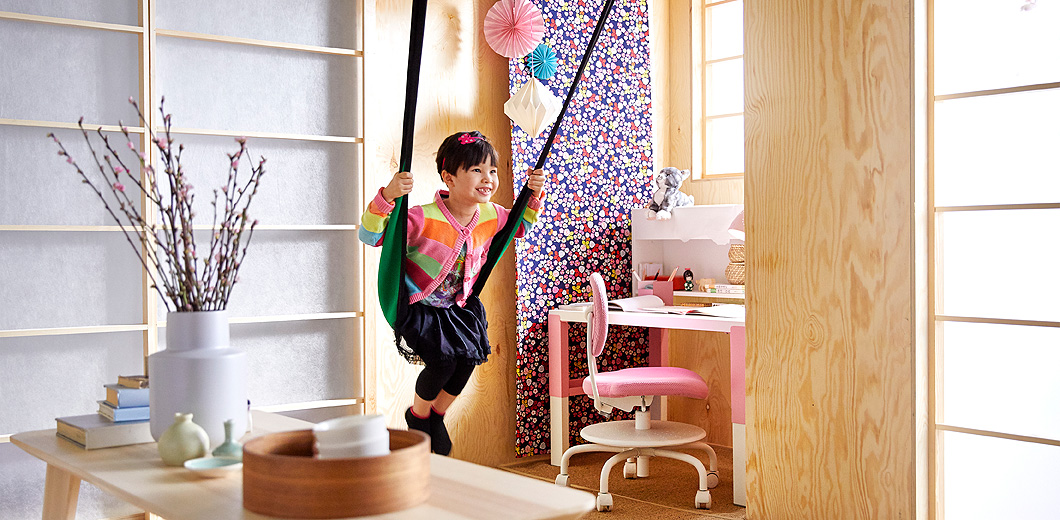 A girl swinging in an indoor swing.