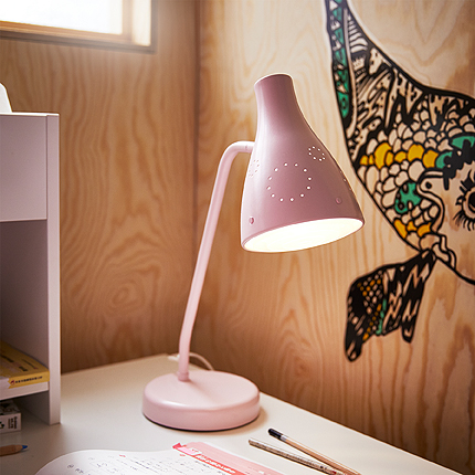 Close-up of a pink work lamp.