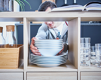 Use our KALLAX storage shelving unit in white stained oak effect as a room divider or a counter – all sides look great! The multitasking shelves can be used for plates, glasses and caraffes as well as for your most inspiring cookbooks.