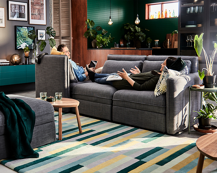 Together or apart, with IKEA VALLENTUNA modular sofas you can create personal zones while staying only on arm's reach away. The sofa-bed module has hidden storage for extra cushions close at hand.