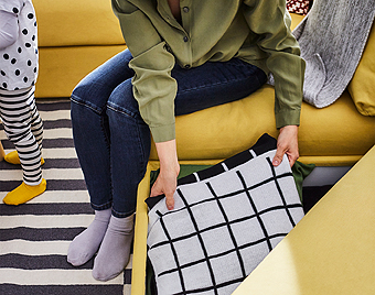 Under the seat of IKEA VIMLE footstool there is a hidden storage where you can store extra cushions or blankets.