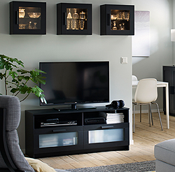 This black BRIMNES TV-bench has large drawer fronts with frosted glass that keep remote controls and other TV accessories organised. Cable outlets make it easy to lead cables out the back, so they're hidden, but close at hand when you need them.
