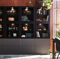 This black-brown BESTÅ storage combination with built in lighting and dark grey glass doors, highlights your most beautiful wine glasses, vases and favourite objects in a sophisticated way. Ordinary objects can be hidden in the bottom drawers.