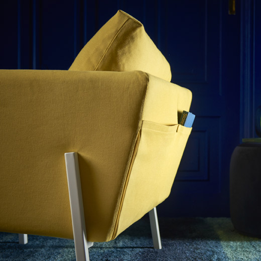 Sit back and relax in IKEA KOARP armchair. It comes with a practical backside pocket and brings a modern comfort to your living room - in a happy yellow color.
