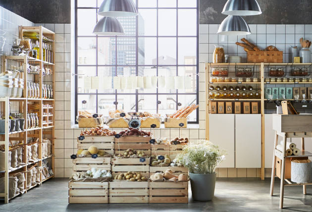 A shop that pops up and stands out with IVAR shelving storage and KNAGGLIG boxes in the foreground.