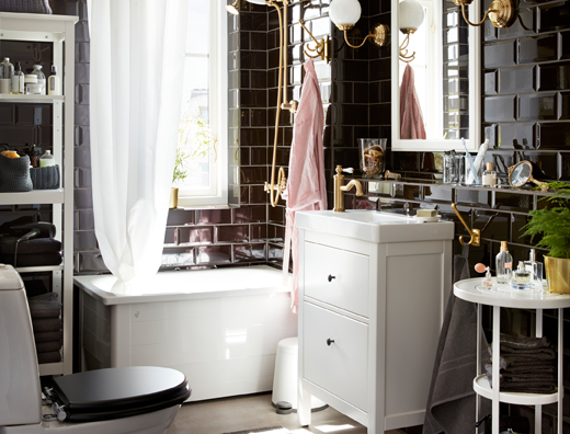 Classic style bathroom with black tiles and white fittings.