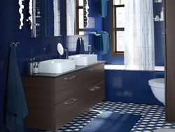 Dark blue and brown bathroom with 2 sink cabinets side by side.