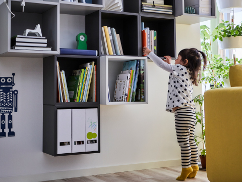 IKEA EKET open wall cabinets in neutral colours and two different depths are perfect for storing books. Hang them low so the children can get their favourite book of fairy tales.