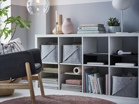 Our white KALLAX shelving unit can be put horizontally as a sideboard. It comes with wire baskets and soft felt inserts that help organise everything from pens to papers, letters and magazines, making the most out of the storage space inside the shelves.