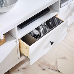 The large drawers of the traditional, white HEMNES TV bench in solid wood, make a great job hiding cables and technology that cramp your interior decoration style. The concealed drawer runners run smoothly even when heavily loaded.