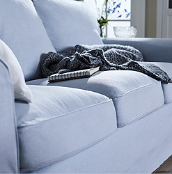 IKEA EKTORP three-seat sofa in light blue polyester has seat cushions that easily regain their shape when you get up.