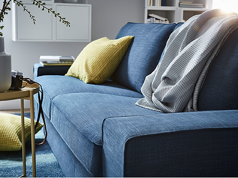 This dark blue KIVIK two-seat sofa has a soft, deep seat and comfortable support for your back. The seat cushions have a top layer of memory foam that moulds to the contours of your body, and regains its shape when you get up.
