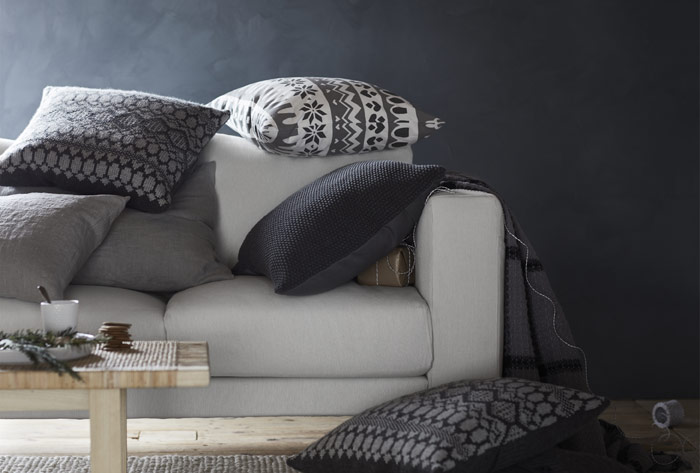 The new IKEA winter cushions are made with 100% fluffy duck feather filling inside and wool and acrylic outside. Grey, white, and black Icelandic patterns adorn the pillows.