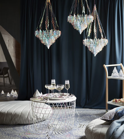 Decorate your holiday party the Scandinavian way with IKEA winter plastic chandeliers, shaped like crystal icicles and painted like the Northern Lights with magical teals, pinks, and blue hues.
