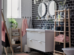 Combine two white GODMORGON/ODENSVIK wash-stand with 2-drawers and a VILTO shelving unit in birch to create a grey, pink and black bathroom with lots of storage.