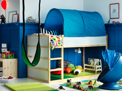 Create a blue and white children's bedroom that dreams are made of with KURA reversible bed in white and pine and KURA bed tent in blue - and provide plenty of space to play underneath too.