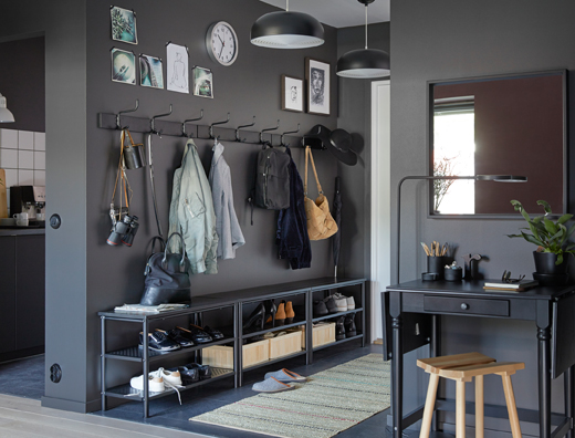Combine three black PINNIG bench / shoe racks and three PINNIG rack with three hooks in a row against a dark gray wall to create plenty of storage in a narrow hallway.
