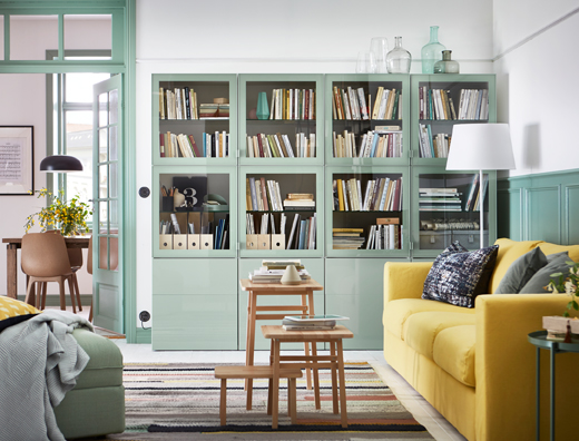 Create a calm living room in green, gray and yellow. Green BESTÅ closed cabinets create space for all your stuff and the VIMLE sofa in yellow allows you to sit back and relax.