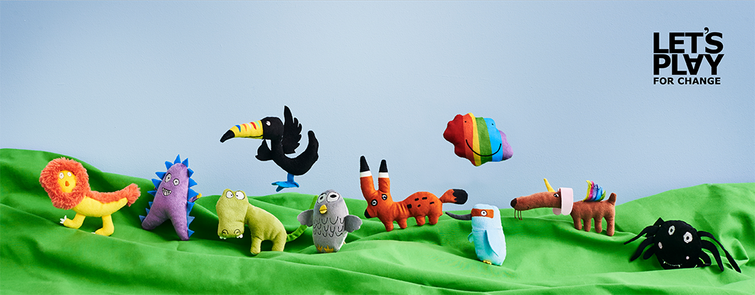 10 cute cuddly SAGOSKATT soft toys in the foreground, the winners from the previous soft toy drawing competition 2016, standing on a green textile floor with a blue background.