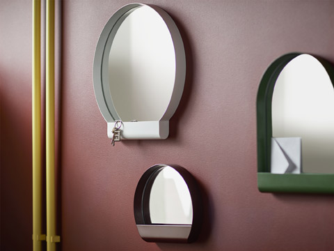 Designed in different sizes and oval shapes, IKEA YPPERLIG steel and glass mirrors come with shelf storage space to fit knick-knacks along the wall.