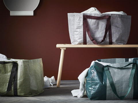The IKEA YPPERLIG plastic carrier bag with weave patterns gives a modern sheek twist to the iconic FRAKTA bag in bold red, white, and green colours.