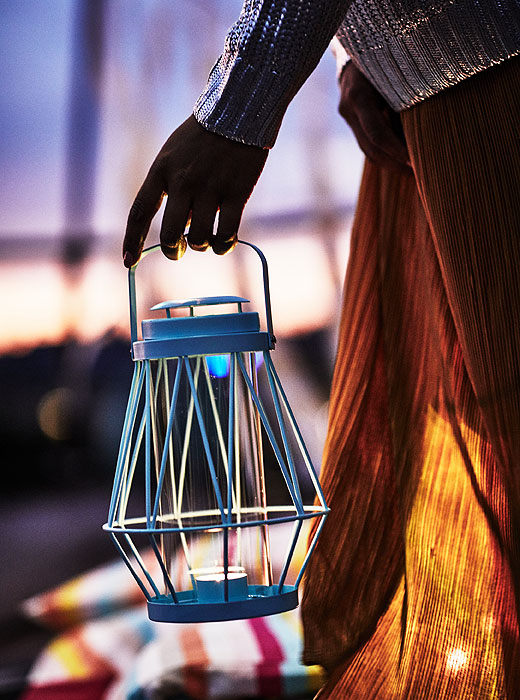 What's the perfect accessory for an evening rooftop gathering? The turquoise SOMMAR 2018 lantern for tealight will help set the mood. IKEA has candle lanterns, decorative lighting and candle holders for all of those special summer moments.