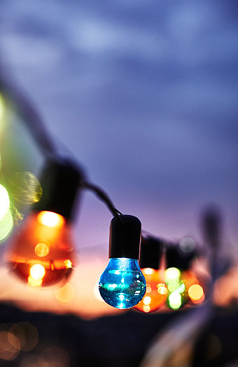 Close-up of multi-coloured string lights.