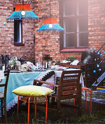 Patio furniture decorated with many coloured deocrations and table decorations.