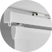 Mounting an IKEA VIDGA white ceiling fitting is easy: it only requires one screw. The curtain rail has no visible screws in sight for a seamless and clean appearance.