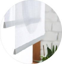 IKEA VIDGA white panel curtain holder helps hang panels in place. Panels up to 2 ft wide can be secured into the plastic slit.