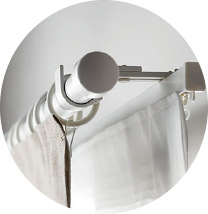 IKEA VIDGA white curtain rod holders keep a pair of curtains steady and provide endless opportunities to mix different types of curtains together.